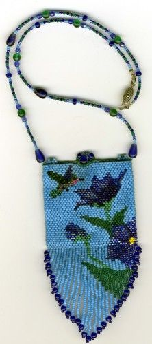 """This Humming bird Amulet bag took 13 hours to make & is made of glass seed beads, fire polished crystals & other glass beads. It is priced at $140. It measures 15"""" in length, with the bag meas"""