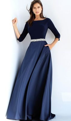 This Jovani 49269 navy blue mother of the bride dress features an A-line silhouette, with three-quarter sleeves to frame the Sabrina neckline and full back. A crystal beaded belt accents this two-tone evening gown, ending in a brush train. Formal Gowns With Sleeves, Evening Gowns With Sleeves, Dress Formal, Hijab Evening Dress, A Line Evening Dress, Simple Evening Gown, Navy Evening Gown, Prom Dress Shopping, Online Dress Shopping