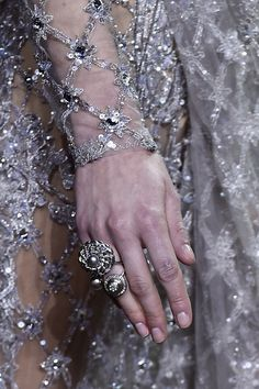 Silver Linings | Haute Couture Spring Summer 2016 details From jewelry to handbags and headpieces, exquisite ornaments of metallics form a dazzling symmetry that extends to bridge the gap between...