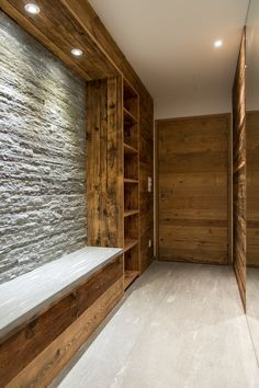 There is plenty of storage in the boot rooms House Entrance, Entrance Hall, Chalet Design, House Design, Chalet Interior, Gun Rooms, Condo Remodel, Kitchen Cabinets In Bathroom, Ski Chalet