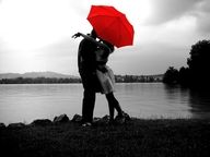 black and white with a red umbrella