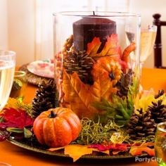 Thanksgiving Ideas, Thanksgiving Decorating Ideas - Party City. Here we created a beautiful, original centerpiece just by mixing and matching a few simple items in a hurricane vase atop a charger.