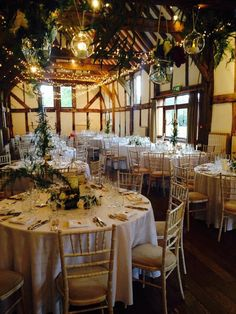 The gorgeous Tithe Barn at Loseley Events, simple crossed strands of fairy lights for a little sparkle!