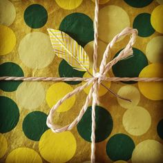 Lokta paper used as gift wrapping with a feather made with masking tape!