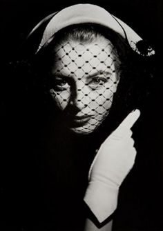 Capucine wearing a hat with veil, 1955. Photo by Georges Dambier.