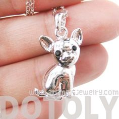 A super cute animal themed necklace featuring a Chihuahua puppy pendant in silver!  The Chihuahua puppy pendant measures 2 cm tall by 1 cm wide and hangs on a 16 inch (41 cm long silver plated chain)