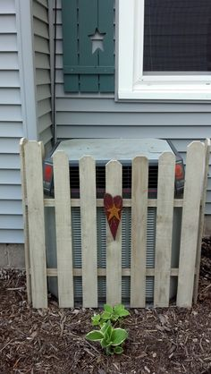 Picket Fence around Air  Conditioner.. however I would like to have this around the trash bins.