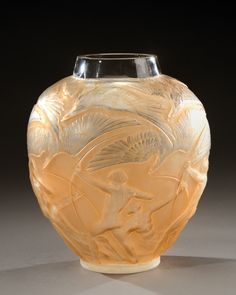 «Archers» a vase in blown-moulded, slightly orangey glass. Signed «R.Lalique France». Model created in 1921.