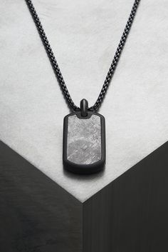Meteorite tag necklace.