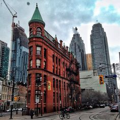 Flatiron building, Toronto. @ Flatiron Building- I like the old and new, right next each other