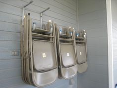 Hang folding chairs on porch