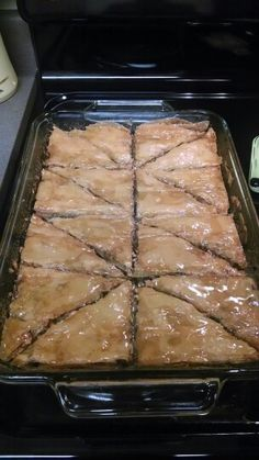 Homemade Baklava.  My own special recipe with ground pistachios, almonds, walnuts, pecans, sugar and cinnamon.  Layers of phyllo dough. Baked. Drizzled with melted butter & agave nectar!  :) yumminess!