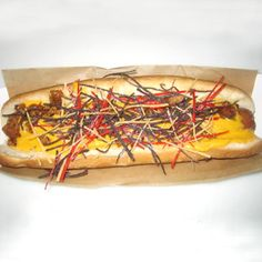 The Arizona Diamondbacks Arizona Dog is kicked up with chorizo sausage, nacho cheese, and colorful, confetti-like tortilla strips.