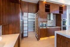 Hidden pantry in modern kitchen.