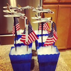 Top Gun themed party. Centerpieces. Styrofoam, pillow stuffing, dowels, plane models, popcorn buckets from party city, and lots of hot glue. Easy and super inexpensive