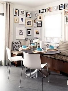 @Brooke Williams Neville, look at this nook!! Pictures and turquoise accents. The chairs are pretty killer too!!!!