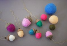 Your colorful felt balls are finished!! Hang them on your tree, add them as toppers to wrapped gifts, or place them all into a pretty bowl as decor.