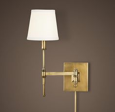 RH's Library Swing-Arm Sconce:Our sconce is equipped with precision hardware that swivels and extends, directing light where you need it.