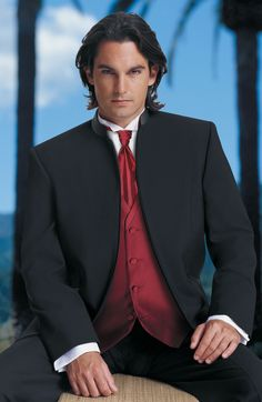 You will love seeing your husband-to-be waiting for you at the alter wearing this handsome black and red suit and tie.