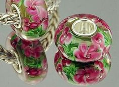 Hey, I found this really awesome Etsy listing at http://www.etsy.com/listing/126381580/lovely-pink-flower-murano-glass-bead