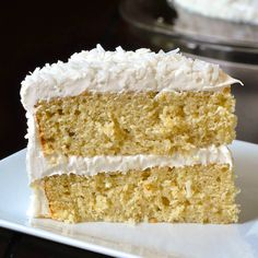 Coconut Velvet Cake. Beautifully moist & tender, flavoured with coconut milk & extract, then covered in coconut marshmallow frosting & dried coconut.
