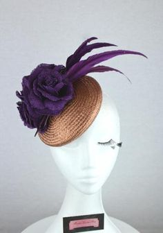 Rose gold straw fascinator with purple straw roses and purple feather accents @ www.marilynvandenberg.com