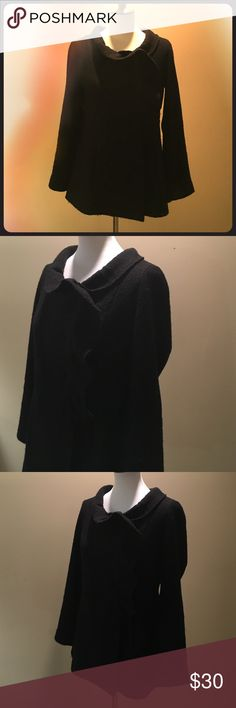 100% Wool Sweater Jacket by Sandro Beautiful 100% Wool Black Sweater Jacket with tulip collar and lapel.  This Sweater Jacket looks great with a pair of jeans or the perfect compliment to any Holiday outfit. Sandro Sweaters