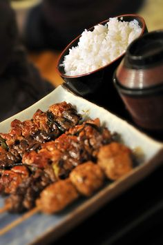 Japanese food- Yakitori (char-broiled chicken)   With Rice!!  That really goes with rice.  Just try it!!