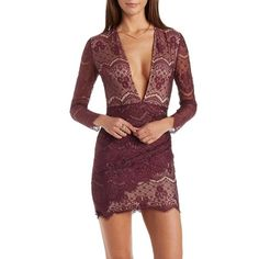 Plunging lace dress Beautiful burgundy lace dress. Very low cut top, I do not recommend wearing a bra. I love this dress but I never wound up wearing it. It will definitely make heads turn. Brand new with tags! Dresses Mini