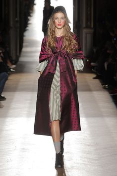 here is the bow feature being used at the opening of a front closure again **Look 01 at Vivienne Westwood #SS15 Gold Label
