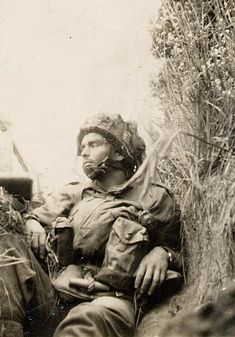 A weary Canadian Paratrooper rests in a slit trench: Juno Beach, Varaville, Normandy, June Canadian Soldiers, Canadian Army, Canadian History, British Army, Battle Of Normandy, D Day Normandy, Normandy Ww2, Ww2 History, Military History