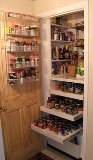 Small pantry, but well organized.  Love the drawers for the lower shelves so that you can see what is in them without getting down on your knees or having to bend way over.  good idea.