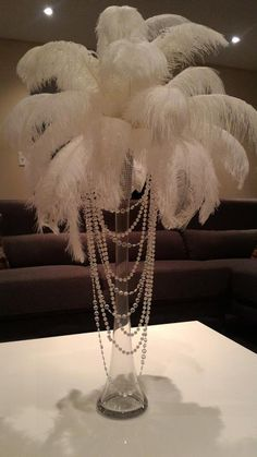 Ostrich Feather Centerpiece with Acrylic and Pearl Garlands for a Vintage Roaring Look! - Informations About Ostrich Feather Centerpiece with Acrylic and Pearl Garlands for a Vintage Roarin - Roaring 20s Party, Gatsby Themed Party, Roaring 20s Wedding, Pearl Themed Party, 1920 Theme Party, 50th Birthday Party Themes, Speakeasy Party, Roaring Twenties, Masquerade Party Decorations