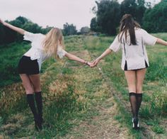 inspiration for sister/bestie pose | hold hands balancing on tracks or rocks