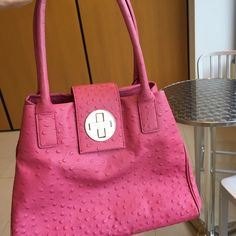 Kate Spade Purse Pink ostrich embossed leather Kate Spade bag. Pre-Owned with much love, there are some marks on the gold clasp, and some visible wear on the handle straps. Yet this is still a great bag, and a great addition to your summer wardrobe! kate spade Bags Shoulder Bags