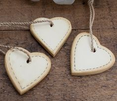 East of India round cream heart in wood on twisted string hanger