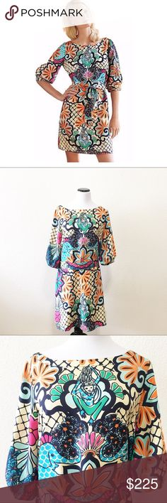 """Lilly Pulitzer sandpiper dress in lillypalooza This is a rare Lilly Pulitzer dress with elephants and monkey's! Hard to find! Absolutely gorgeous size 12! It is 100% silk! The chest measures flat 20"""" and the length is 37""""! Lilly Pulitzer Dresses Midi"""