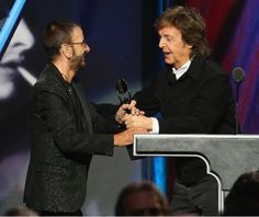 ROCK & ROLL HALL OF FAME ~ Photo: Paul McCartney inducted Ringo Starr (as a solo artist) into the Rock & Roll Hall of Fame on April 18, 2015. The Beatles, as a group, are already in the Hall of Fame.