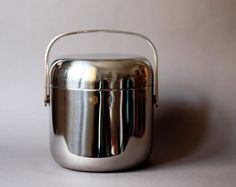 """Ice bucket designed by Timo Sarpaneva.    Sarpaneva designed the stainless steel OPA-series in 1970 for the exhibition """"Glass and Steel"""" at the Pinx Art Gallery June 15th, 1970."""
