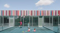 ABLM Arquitectos uses mirrored panels and stripy tiles for Spanish school