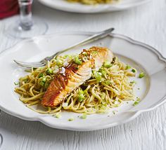 Salmon with sesame, soy & ginger noodles. This simple, Asian-inspired fish and fried noodle dish makes a perfect casual, mid-week supper