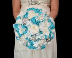 Beach Theme Wedding  Bouquets with turquoise and white roses, seashells, starfish, jewels, brooches, pearls