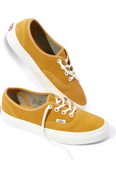 Rich golden suede brings varsity style to this iconic lace-up low-top from Vans that's fitted with metal eyelets and a signature waffled sole.