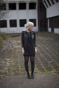Cool simple all black outfit with spiked loafers.