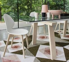 The LEVANTE extendable dining table combines the tactile nature of wood with the transparency of the glass top which reveals a touch of colour. Fitted with two side extension leaves, LEVANTE can seat up to 12 guests. Wooden Dining Chairs, Contemporary Dining Chairs, Glass Dining Table, Contemporary Furniture, Dining Room, Sofa Furniture, Outdoor Furniture Sets, Outdoor Decor, Banquette