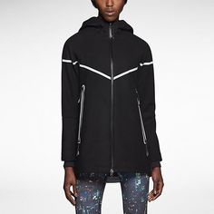 Nike Reflective Jacket Wear everywhere sleek look, reflective back and stripes on front. Great condition. Feel free to ask questions/make an offer! Very warm. Nike Jackets & Coats Utility Jackets