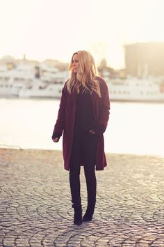 Wear a burgundy coat this winter for a simple chic take on the oxblood color trend