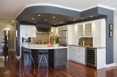 Love the dropped & painted ceiling in this kitchen by Brrian Dittmar. Nice way to separate spaces in an open floor plan.