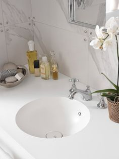 DuPont Corian white solid surface bathroom vanity with seamless integrated sink