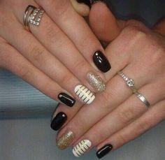 Black & gold designs nails.